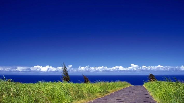 highway-grass-sea-sky-hd-wallpaper-710x400